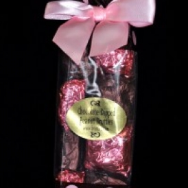 12 Chocolate Dipped Peanut Bruttles wrapped in pink and brown foil and put into a brown with pink polka dots bag with a pink satin bow