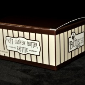8 oz Soft Cashew Butter Brittle Box in a brown box with tan stripes