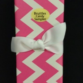 Medium Sampler in a pink chevron gift wrapped box with a white ribbon