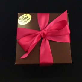 Large Sampler in a brown box with fusia satin ribbon