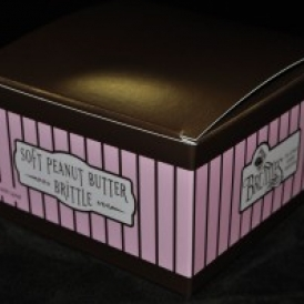 16 oz Soft Peanut Butter Brittle in a pink and brown stripped box
