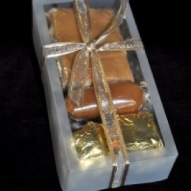 Micro Sampler in a clear box with satin ribbon