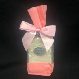Double Chocolate Peppermint Bark in a clear and pink cello bag with a pink satin bow