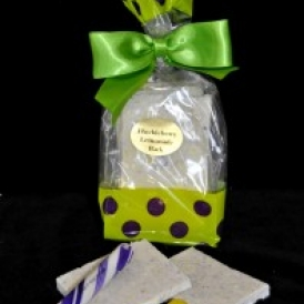 Huckleberry Lemon Bark in a green and clear cello bag with purple polka dots and closed with a green stain bow
