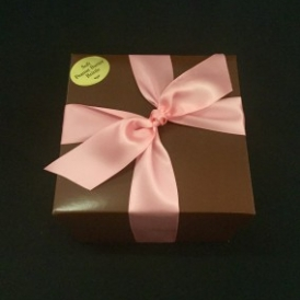 2# Soft Peanut Butter Brittle in a pink and brown box and tied with brown satin ribbon