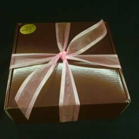3# Soft Peanut Butter Brittle in a black box with gold ribbon